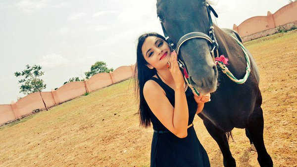 Madirakshi Mundle with horses