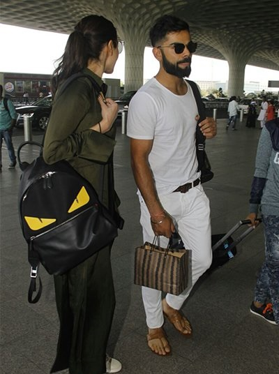 virat-kohli-anushka-sharma-on-the-way-to-yuvi-hazel-wedding-in-goa